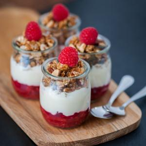 Yoghurt with crushed raspberry and granola